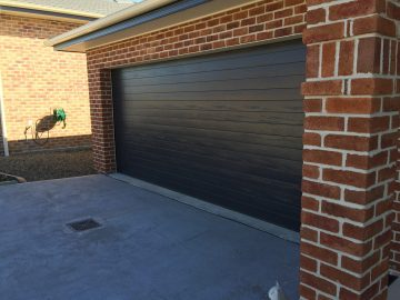 Image result for panel lift garage door